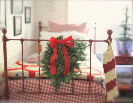 wreath on wrought iron bed...
