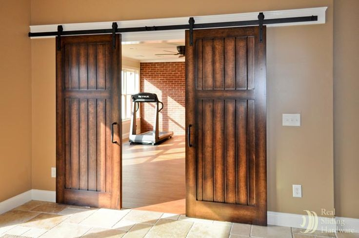 sliding barn doors on a basement gym