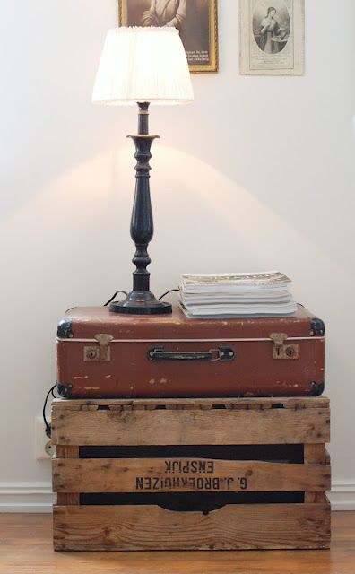 ... homemade nightstand using an old crate, vintage suitcase... love this