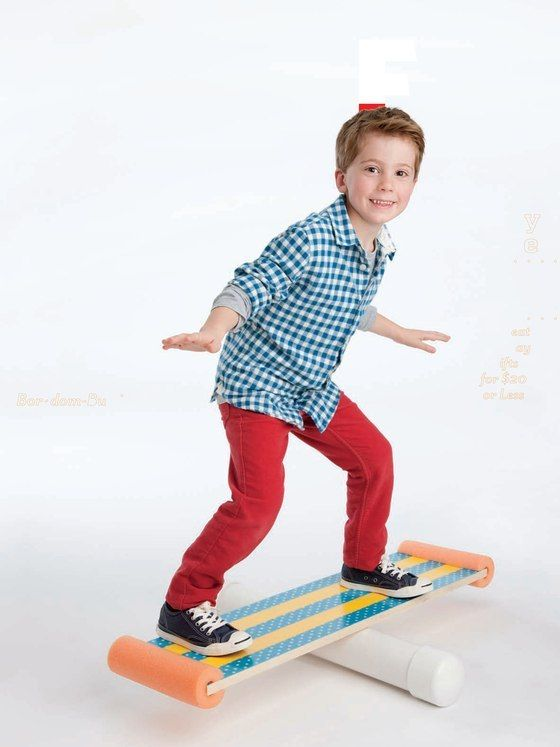 balance board made with pvc pipe, swim noodles, and I'm not sure what the board is
