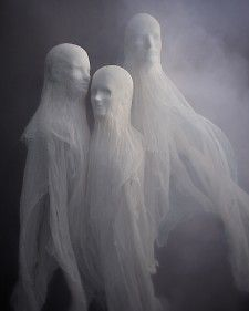 Cheesecloth Spirits using styrofoam mannequin heads, place eye hook at the top of head then fishing line to hang. Creepy!!!
