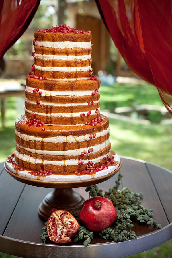 naked wedding cake with pomegranate