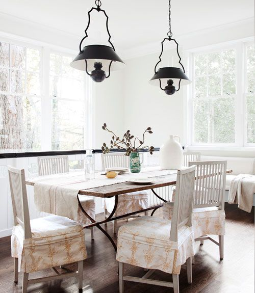 From Country Living.  Sweet slipcovered chairs!