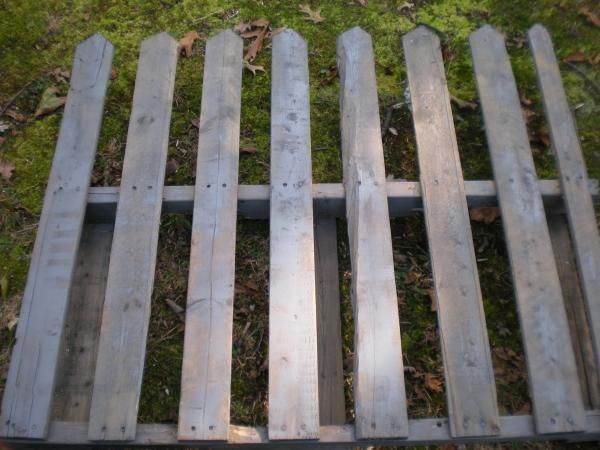 Pallet fence garden pinterest for Pallet picket fence
