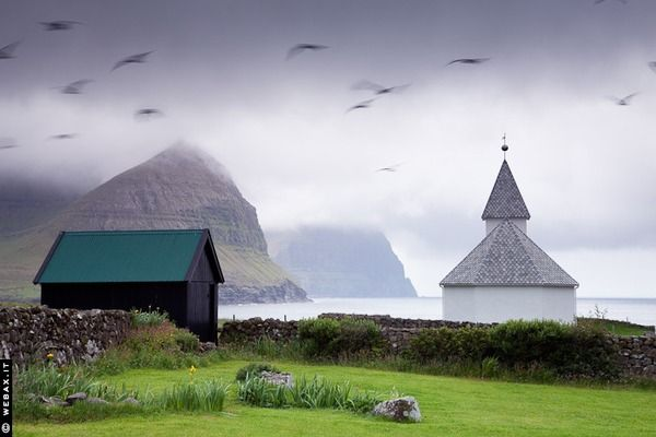 Faroe Islands...The Lord of the Rings' scenery of Faroe Islands truly makes you believe the archipelago is inhabited by hobbits and elves. Located halfway between Iceland and Norway, in the heart of the Gulf Stream in the North Atlantic, the 18-island archipelago is home to beautiful dramatic landscapes of volcanic peaks and oceanic waves hitting against the rocky shoreline. The islands' magical and mysterious scenery seems to be much closer to the fantasy world than to reality.