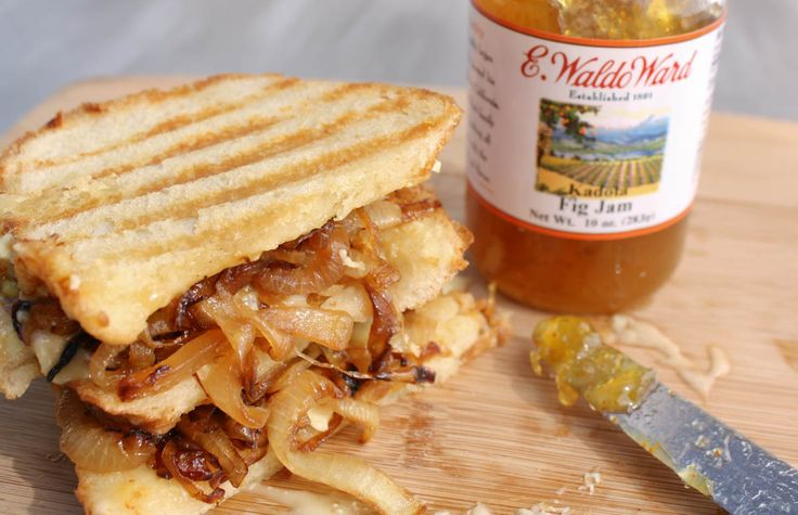 oozing brie and prosciutto panini with fig jam and caramelized onions