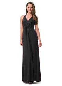 Long and beautifully draped jersey dress features charmeuse lattice detail around the halter neck and bust. Gathers on the empire waist are designed to flatter every figure. The halter clasps at the back of the neck, with a slight open back shape and straight line topping the long skirt. Back zip. Lined bodice. Dry clean only.