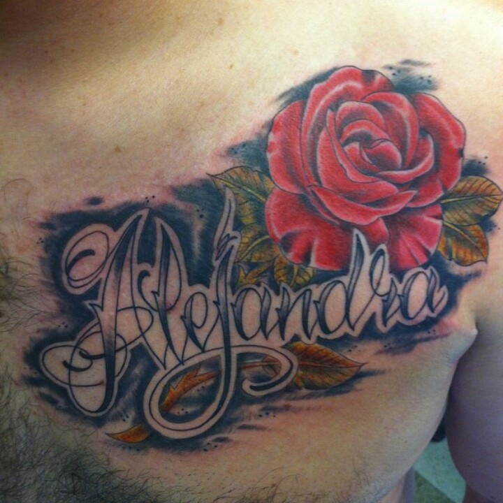 My husband's rose tattoo with my name. (Stem is bleeding ...