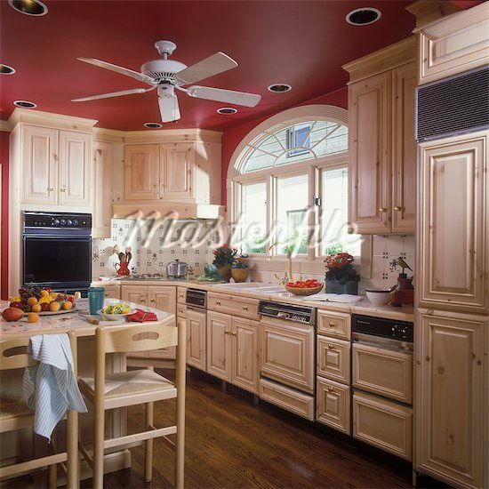 like this red wall kitchen , the red ceiling and white cabinets