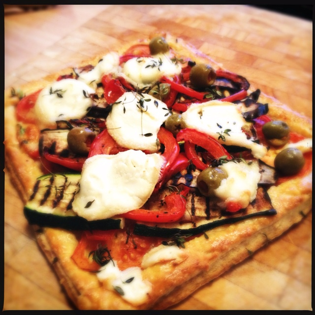 ... zucchini and peppers tart, topped with lemon thyme and goats cheese