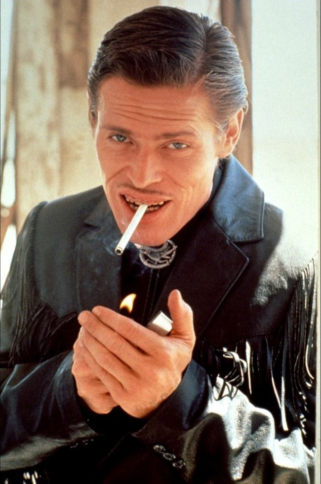 Willem Dafoe smoking a cigarette (or weed)