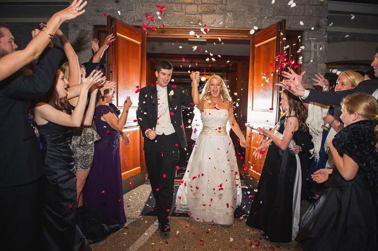 Fun wedding exit with rose petals!