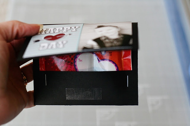 "Valentine's Day DIY craft. Matchbook Valentines.   what you'll need:        black cardstock      double sided tape (or other adhesive)      stapler      valentine fun dips    step one... Trim your cardstock to 4 1/2 x 8 1/2 inch strips. Then, with your paper horizontal, score it at the 3 1/2"" and 7"" marks.  step two... Attach your Valentine on the far left block, then fold at your score lines and insert the Fun Dip inside. Staple it in on both sides.  step three... Place a piece of double sided tape to hold the top flap down."