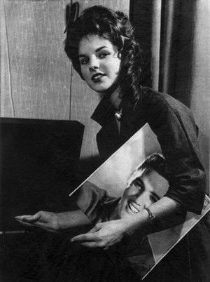 Sixteen-year-old Priscilla Beaulieu in Wiesbaden, Germany, on March 1, 1960, with a record of Elvis Presley's. Priscilla, of Austin, Texas, is the daughter of an Air Force captain. She had been Elvis' steady date for the previous six weeks. Presley was slated to return to the U.S. for discharge the next day after nearly 18 months in Germany. The two would marry May 1, 1967, in Las Vegas.