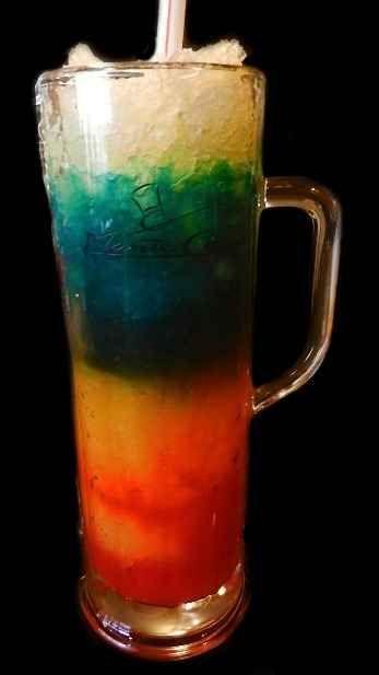 Icy Blue Whale.  ( sounds delish)  1 part blue curacao  1 part vodka  1 part orange juice  1 part pineapple  1 part sweet & sour mix