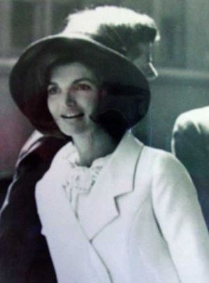 jackie bouvier kennedy in white coat and hat.jpg