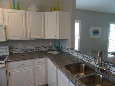 kitchen with new quartz countertops, deep stainless sinks, dishwasher ...