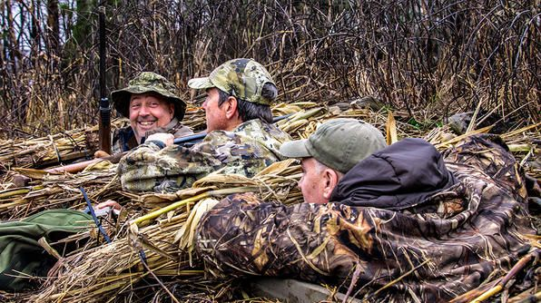 Andrew Zimmern, hunter Chris Nischan and game warden C.J. Jaynes wait in a Sandhill Crane blind to shoot, well, crane.