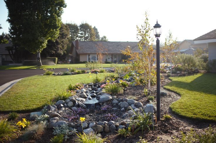 A lamp post and other lighting elements were incorporated into this elaborate landscaping design ...