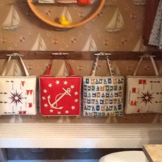 Love this - vintage boat cushions hung on boat cleats.