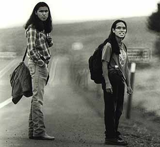a review of the movie smoke signals Smoke signals'' is, in a way, a continuation of a 1989 movie named powwow highway,'' in which farmer starred as a huge, gentle, insightful man, and a martinez as more modern'' it, too, was a road movie, and it lived through its conversations.