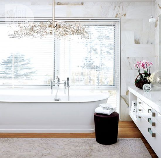 white bathroom, warmed by wood floors. Love the cabinet pulls!