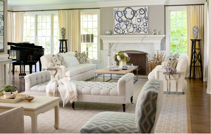 "Our living room is long and skinny, with a fireplace at the end, great idea for furniture arrangement; two ""semi"" separate sitting areas"