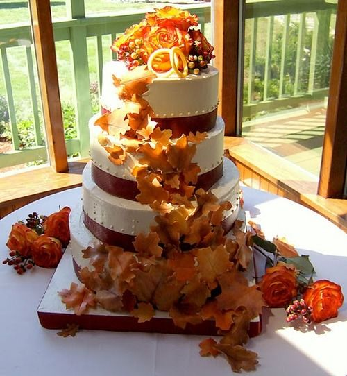 A friend of mine has really taken off in her cake decorating bizcheck out this Autumn wedding cake. NEW! (Sept, 2010) Autumn Leaves Wedding Cake (3 of 4): Apple Spice Cake with homemade applesauce filling, and Dulce de Leche Italian Meringue Buttercream. Leaves and wedding bands are marzipan. Four tiers, with diameters of 8, 10, 12, and 14, serves about 175 people.