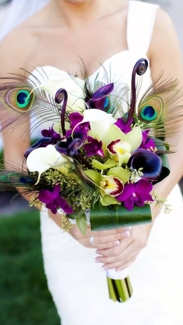 Colorful #bouquet with peacock feathers. #wedding