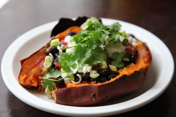 Salsa-topped sweet potato with black beans, feta, green onions ...