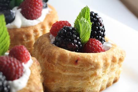 fresh berries in a puff pastry basket with coconut whipped cream ...