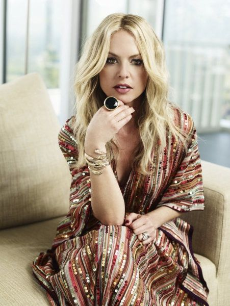 Rachel Zoe is wearing a Missoni caftan and vintage Yves Saint Laurent ring.