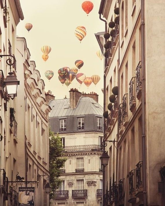 Hot air balloons over Paris street...