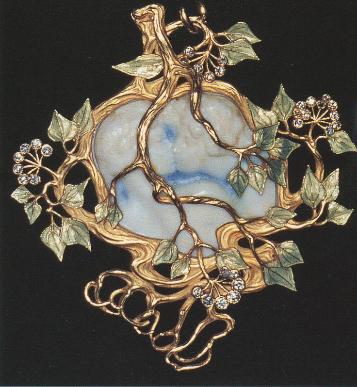 Lalique 1900 'Kiss' Pendant: ivory/ enamel/ gold/ diamonds. Pin found by Nancy Shogren on 9/20/2014