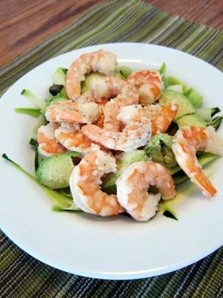 shrimp cooked in butter and garlic on top of zucchini ribbons with ...