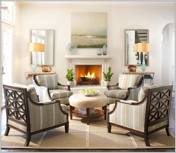 .4 chairs around an  ottoman, a perfect set-up for a living room visiting area.