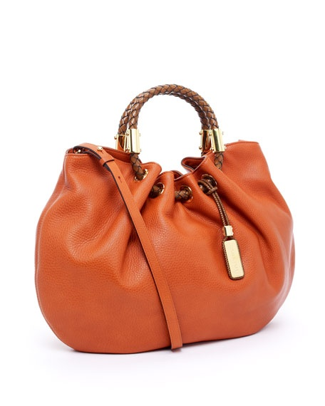 Michael Kors  Skorpios Ring Tote, Tangerine.  My favorite purse. I've had it for more than a year and it still looks like brand new.