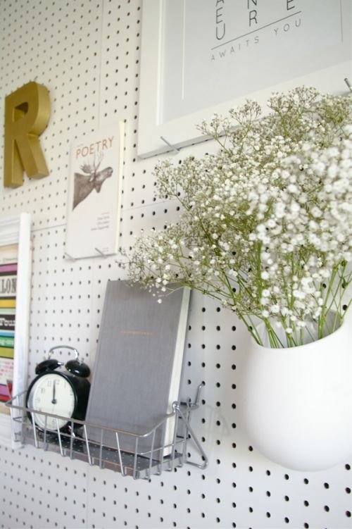use pegboard painted white in laundry room or bathroom closet/nook for storage  How To Make A Pegboard Headboard For Useful Accessories | Shelterness