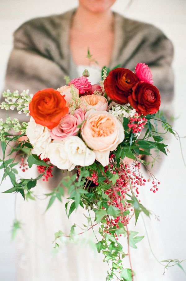 Inspiration for bride bouquet shape and texture. Lots of trailing greens and berries. If possible, I would love a bouquet that doesn't show the stalks.    Also inspiration for fade of color--brights colors mixed with muted.    It's missing the dark accents and yellow/orange family