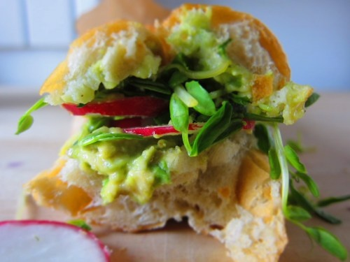 white anchovy sandwich with avocado, hard-boiled egg + radishes