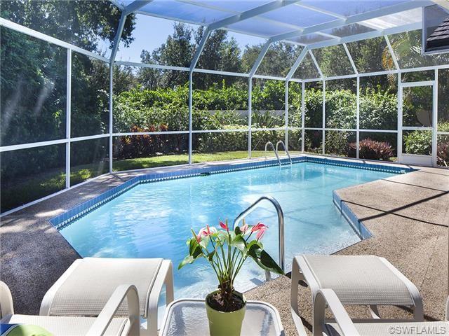 Pretty backyard pool St Andrews at Pelican Bay | Naples, Florida