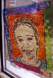 self portraits - print b photo with 1-2 inch border, students trace onto 12-gauge clear vinyl with black sharpie, color.  (This will stick to the window if you get the window a bit wet first.  Just don't put the marker side against the window.)