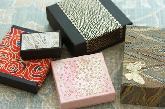 Easy gift boxes - cover plain (or logo'd) boxes in decorative paper