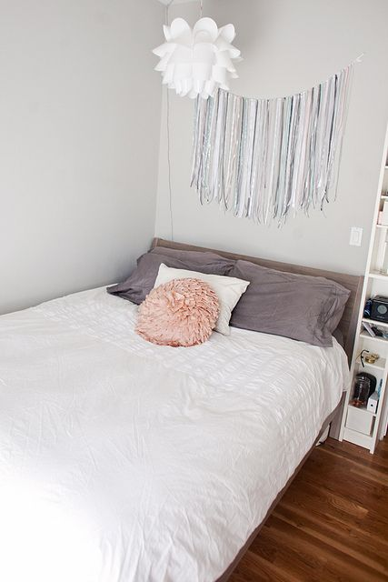 cute room! love the ribbon adornment over the bed