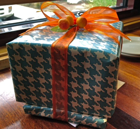 aqua houndstooth wrapping paper -- and the orange bow is the perfect complement!