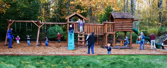 Residential backyard wooden outdoor swingset and wood playgrounds by