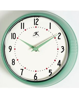 Keep time in retro style with this mint-colored wall clock. Get it here: www.bhg.com/shop/infinity-instruments-infinity-instruments-retro-round-metal-wall-clock-in-green-p5086fe5982a7534baad7dd5b.html