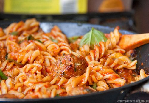 Pasta with a spicy tomato sauce and meatballs