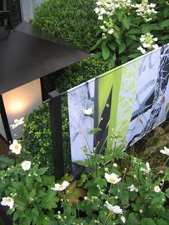 impression textile pour un brise vue dans le jardin