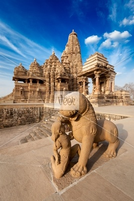 King and lion fight statue and Kandariya Mahadev temple Stock PhotoKandariya Mahadeva Temple Inside
